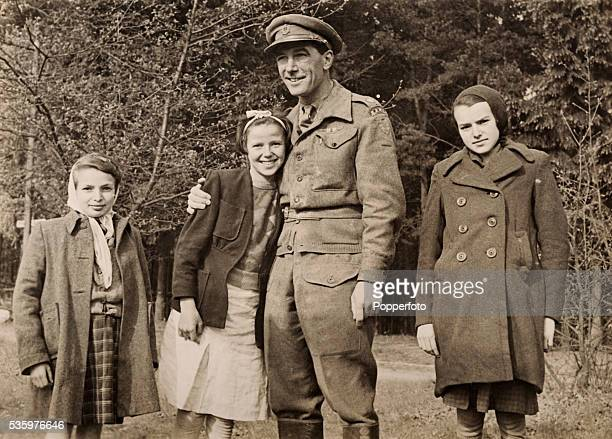 British RAMC officer with three children inside Belsen Concentration camp after it was liberated by British troops 15th April 1945 The Royal Army...