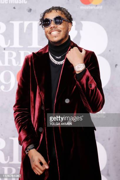 British rapper AJ Tracey poses on the red carpet on arrival for the BRIT Awards 2019 in London on February 20, 2019. / RESTRICTED TO EDITORIAL USE NO...