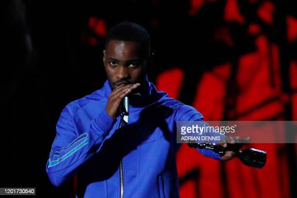 British rapper Dave collects his award for Album of the Year for 'Psychodrama' during the BRIT Awards 2020 ceremony and live show in London on...