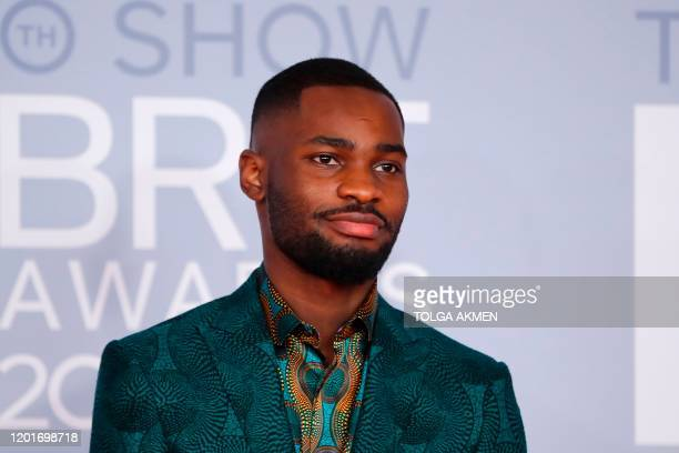 British rapper Dave poses on the red carpet on arrival for the BRIT Awards 2020 in London on February 18, 2020. / RESTRICTED TO EDITORIAL USE NO...