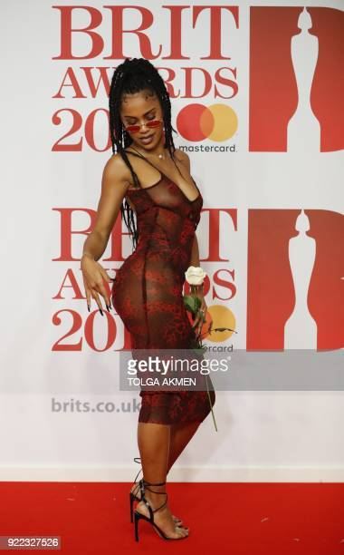British rapper Diana De Brito known as IAMDDB poses on the red carpet on arrival for the BRIT Awards 2018 in London on February 21 2018 / AFP PHOTO /...