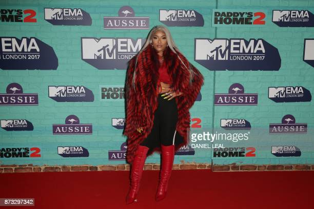 British rapper Stefflon Don poses on the red carpet arriving to attend the 2017 MTV Europe Music Awards at Wembley Arena in London on November 12...