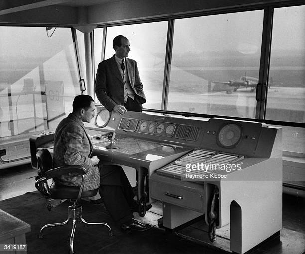 British record breaking pilot Neville Duke in the Hawker control tower at Dunsfold airfield. Original Publication: Picture Post - 7061 - Jet Age -...