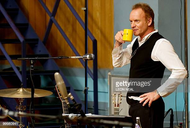 British recording artist Sting holds an 'Abbey Road' mug as he rehearses with the Royal Philharmonic Orchestra at Abbey Road Studios in west London...