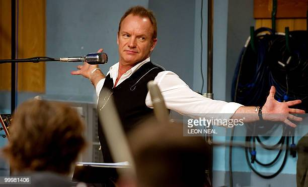 British recording artist Sting stretches during rehearsals with the Royal Philharmonic Orchestra at Abbey Road Studios in west London on May 19 2010...