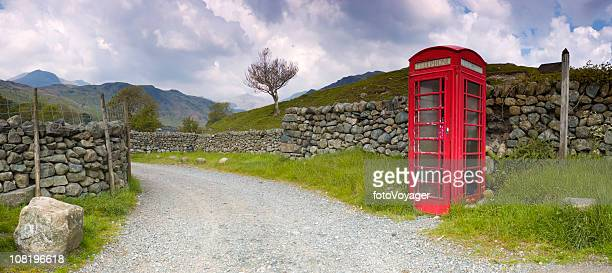 british red telephone booth near dry stone walls - telephone box stock pictures, royalty-free photos & images