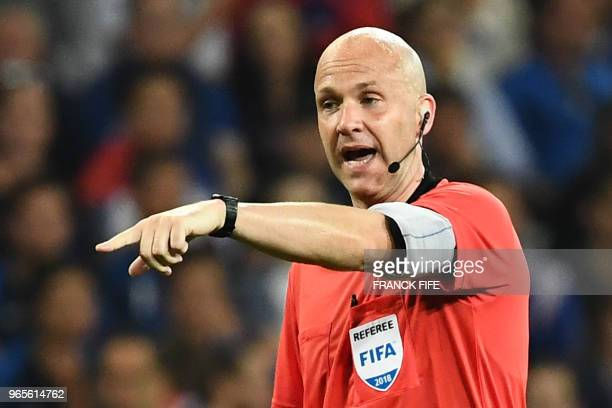 British referee Anthony Taylor gestures during the friendly football match between France and Italy at the Allianz Riviera Stadium in Nice...