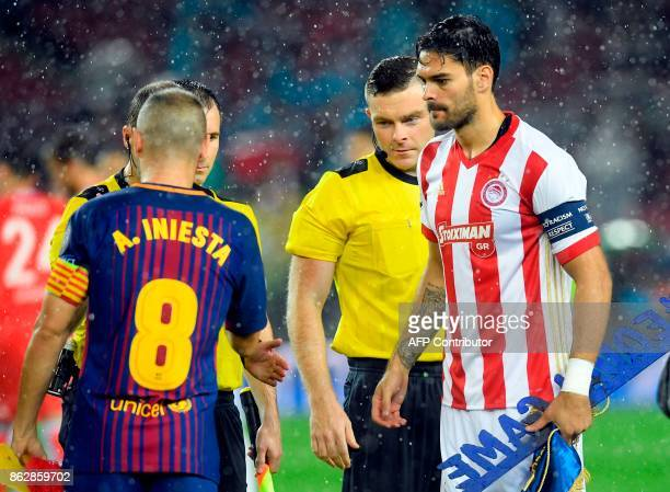 British referee Douglas Ross stands on the field before the UEFA Champions League group D football match FC Barcelona vs Olympiacos FC at the Camp...