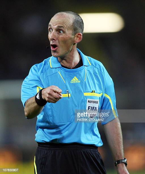 British referee Mike Dean gestures during the Europa League Group J football match Borussia Dortmund against FC Sevilla on September 30 2010 in...