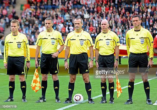 British referees Michael Jones Peter Kirkup Martin Atkinson Michael Mullarkey and Andre Marriner wait before the UEFA Europa League football match...