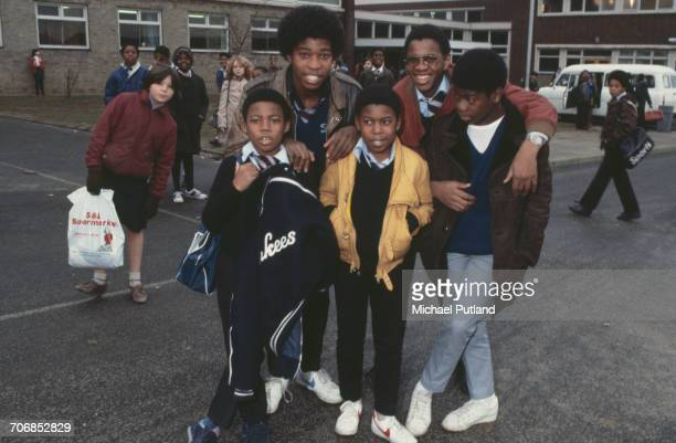 British reggae group Musical Youth posed in the playground at their school Duddeston Manor School Birmingham UK 1982 Clockwise from front left...