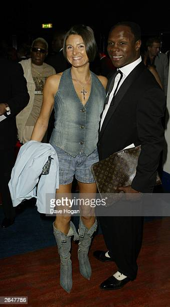 British retired boxer Chris Eubank and his wife attend the MOBO Awards at London Arena on October 1 2002 in London