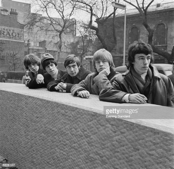 British rhythm and blues group The Rolling Stones leaning on a wall in London They are from left to right Mick Jagger Keith Richards Charlie Watts...