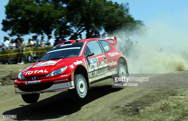 British Richard Burns and his codriver Robert Reid with their Peugeot 206 WRC speed over a dump in the special stage of Elatia during the 50th...