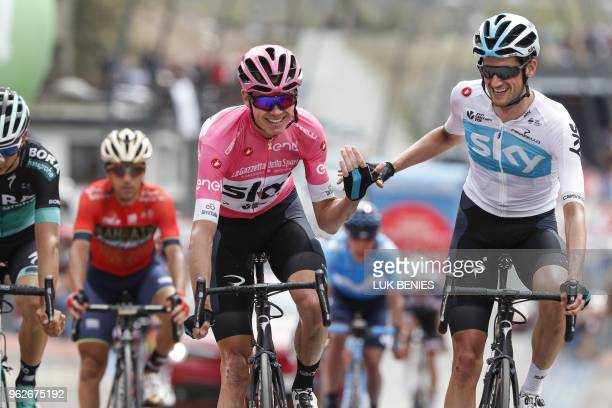 British rider and pink jersey Christopher Froome crosses the finish line with Dutch teammate Wout Poels during the 20th stage from Susa to...