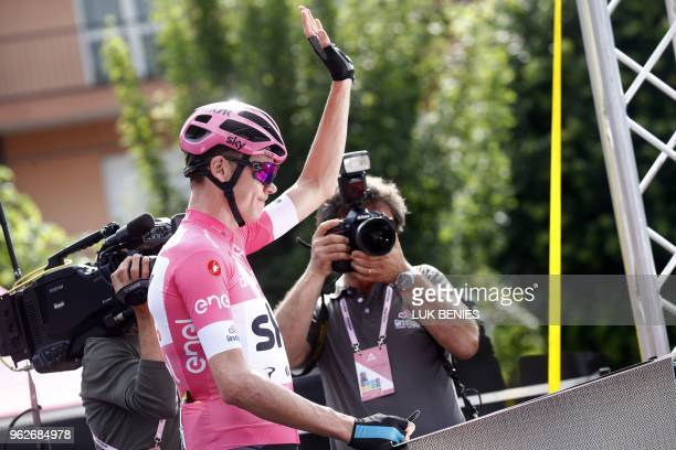 British rider and pink jersey leader Christopher Froome waves the start of the 20th stage from Susa to Cervinia in the 101th Giro d'Italia, Tour of...