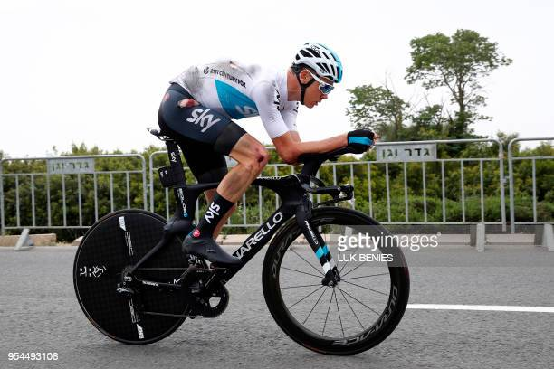 TOPSHOT British rider Christopher Froome rides after a crash during reconnaissance of the route in the 97 km 1st stage of the 101th Giro d'Italia...