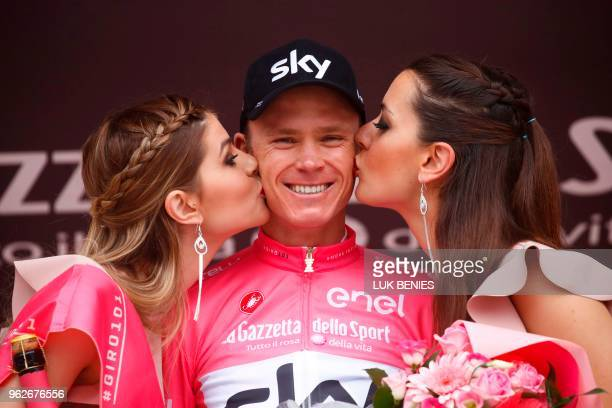British rider Christopher Froome wearing the pink jersey celebrates on the podium the pink jersey after competing in the 20th stage from Susa to...
