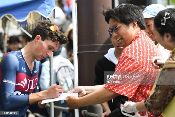 British rider Ian Bibby from JLTCondor team signs autographs to fans after he wins the opening stage 26km Individual Time Trial in Daisen Park Sakai...