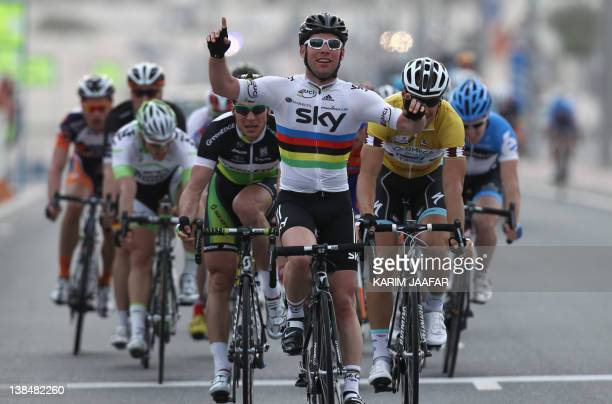 British rider Mark Cavendish of the Sky team celebrates after winning a sprint finish for the 146 kilometre third stage of the Tour of Qatar cycling...