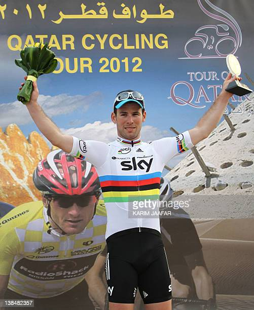 British rider Mark Cavendish of the Sky team celebrates on the podium after winning a sprint finish for the 146 kilometre third stage of the Tour of...