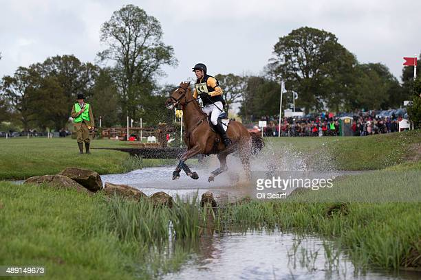 British rider Nick Gauntlett on his horse 'Grand Manoeuvre' clears the Mirage Pond jump of the Cross County discipline on the penultimate day of the...