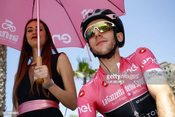 British rider Simon Yates, wearing the overall leader's pink jersey, waits for the start of the 159 km seventh stage of the 101th Giro d'Italia, Tour...