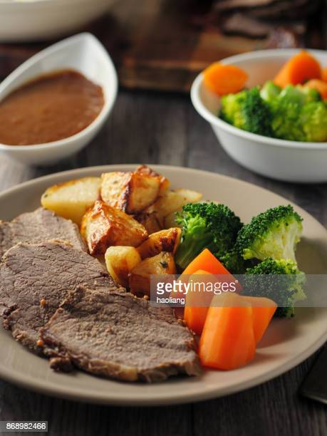british roasted beef dinner - gravy stock photos and pictures
