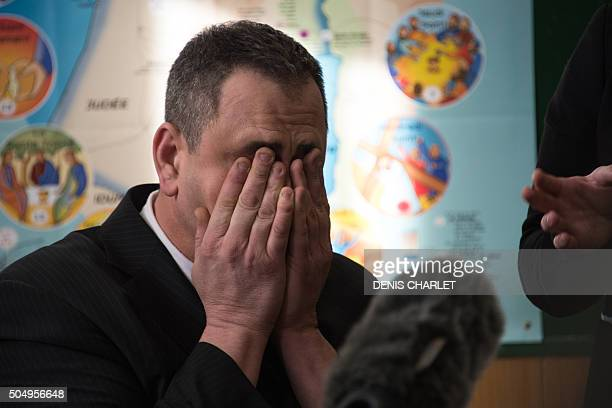 British Robert Lawrie reacts as he addresses the media on January 14, 2016 in Boulogne-sur-Mer prior to the start of his trial for trying to bring a...