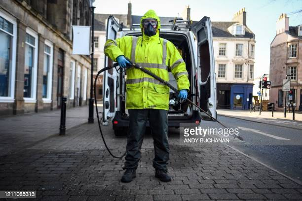 British Robin Barclay cleaning contractor poses on a street in Glasgow Scotland on April 18 2020 during the COVID19 coronavirus pandemic Ahead of May...