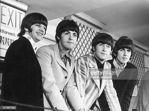 British rock and roll band the Beatles from left Ringo Starr Paul McCartney John Lennon and George Harrison answer questions at a press conference in...