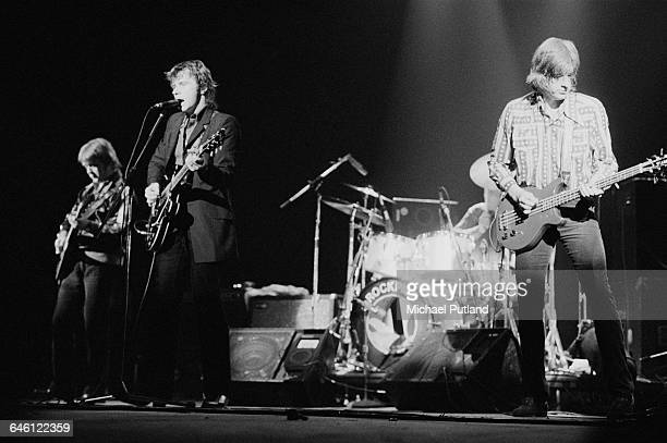 British rock and roll group Rockpile performing in New York August 1979 Left to right Billy Bremner Dave Edmunds and Nick Lowe