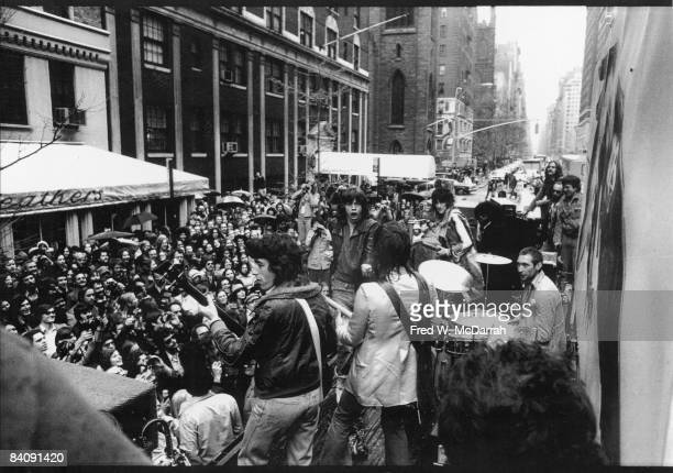 British rock and roll group the Rolling Stones perform on a flatbed truck on 5th Avenue New York New York May 1 1975 AMong those pictured are band...