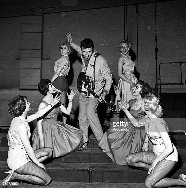 1959 British rock and roll performer Marty Wilde pictured in action with beautiful dancing girls