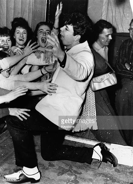 British rock and roll singer Cliff Richard already a star at nineteen years old sends his fans wild with his dancing