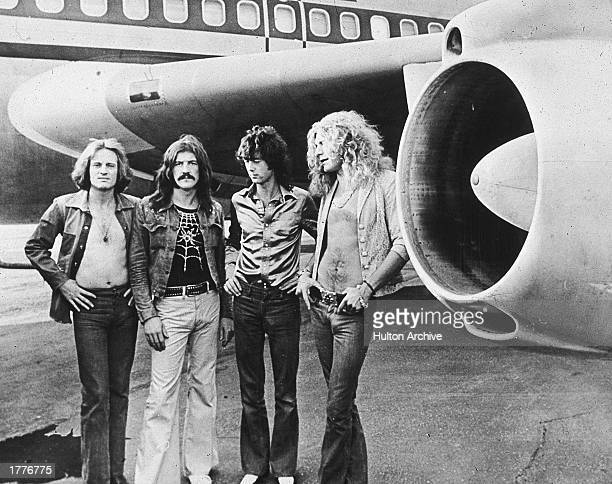 British rock band Led Zeppelin John Paul Jones John Bonham Jimmy Page and Robert Plant pose in front of an their private airliner The Starship 1973