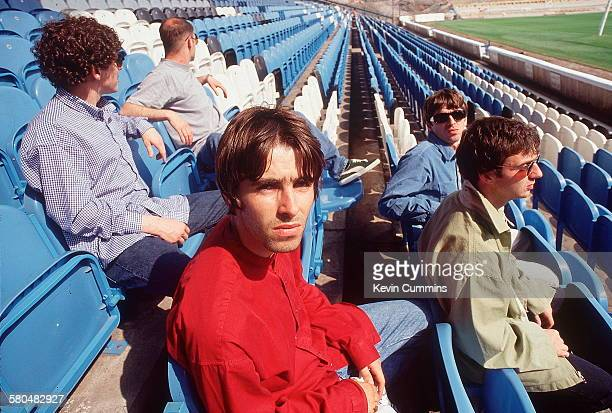 British rock band Oasis at Manchester City's Maine Road stadium Manchester 2nd August 1994 Left to right drummer Tony McCarroll rhythm guitarist Paul...