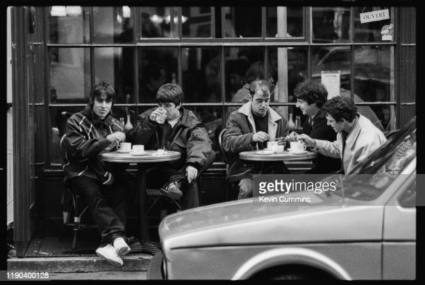 British rock band Oasis outside a cafe in Frith Street, London, 17th March 1994; singer Liam Gallagher, guitarist Noel Gallagher, rhythm guitarist...