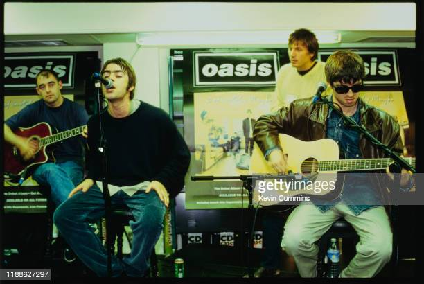 British rock band Oasis performing live at an in-store promotion gig, UK, 1994; they are Paul Arthurs, Liam Gallagher, Noel Gallagher and Evan Dando...
