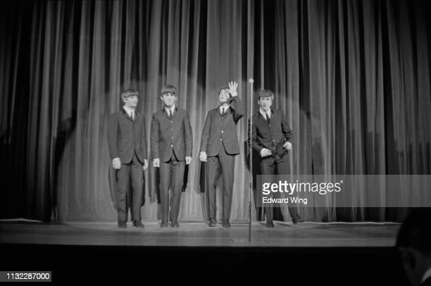 British rock band The Beatles on stage at the London Palladium, UK, 13th October 1963; Ringo Starr, George Harrison , Paul McCartney, John Lennon .