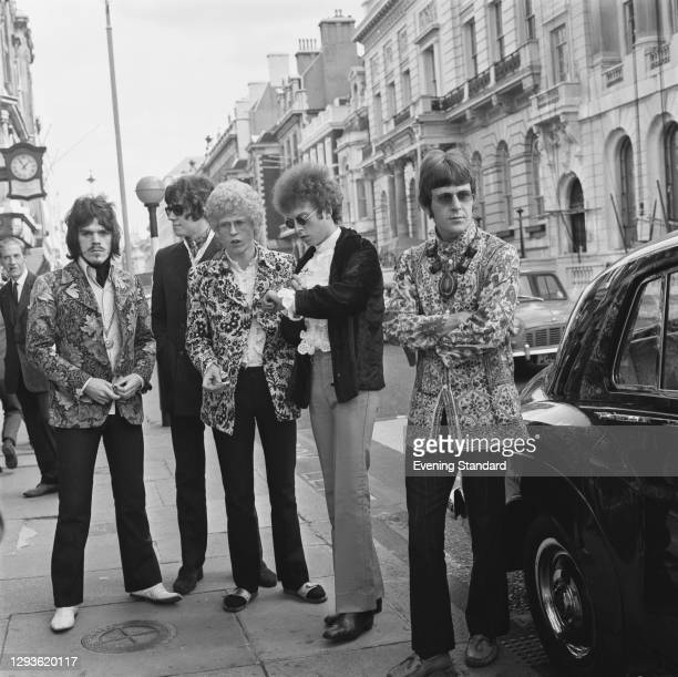 British rock band The Move attend court in London during a libel action, after they published a cartoon of Prime Minister Harold Wilson in the nude...