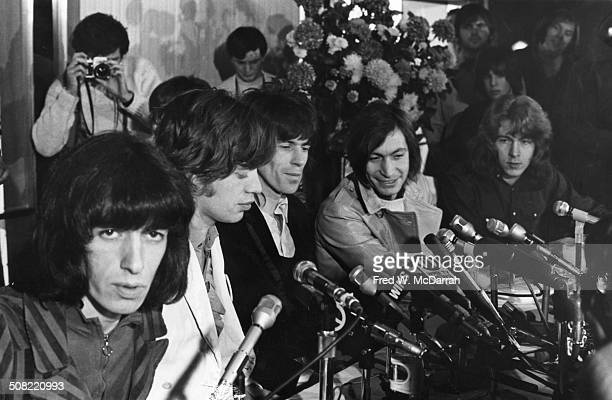 British rock band the Rolling Stones sit behind a bank of microphones during a press conference New York New York November 27 1969 Pictured are fore...