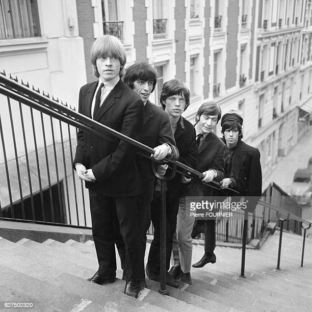 British rock band The Rolling Stones with members Brian Jones Bill Wyman Mick Jagger Charlie Watts and Keith Richards in the streets of Montmartre in...