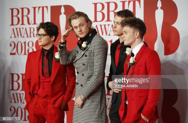 British rock band 'The Vamps' Brad Simpson James McVey Connor Ball and Tristan Evans pose on the red carpet on arrival for the BRIT Awards 2018 in...