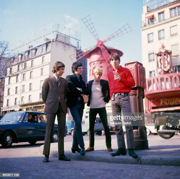 British rock band The Who, composed of lead singer Roger Daltrey, guitarist Pete Townsend, drummer Keith Moon, and bassist John Entwistle, stand in...