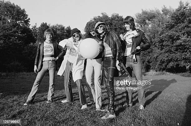 British rock group Hawkwind outside Rockfield Studios Wales circa 1979 Left to right guitarist Huw LloydLangton guitarist and singer Dave Brock...