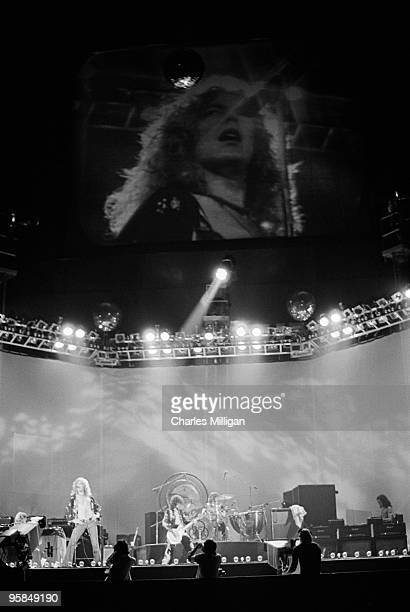 British rock group Led Zeppelin performing 1976 Guitarist Jimmy Page is centre stage while singer Robert Plant can be seen on the left and on the...