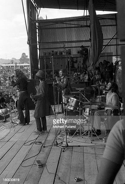 British rock group Led Zeppelin performing at the Bath Festival, Shepton Mallet, 28th June 1970. Left to right: singer Robert Plant, guitarist Jimmy...