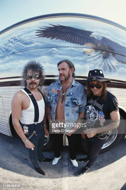 British rock group Motorhead satnding by their tour bus circa 1980 Left to right drummer Phil 'Philthy Animal' Taylor bassist and singer Lemmy and...