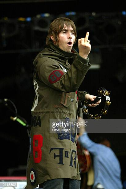 British rock group Oasis' frontman Liam Gallagher raising his middle finger to the crowd during the Finsbury Park Concert on July 5 in London England